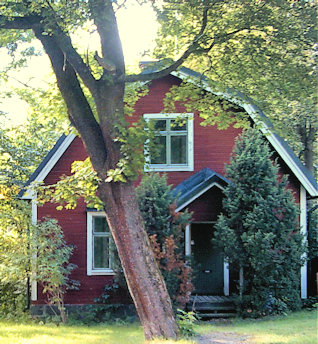 Red cottage with white trim